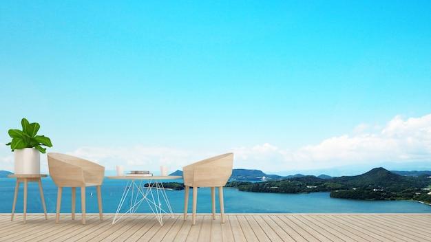 Coin repas sur terrasse avec vue mer dans hôtel ou restaurant