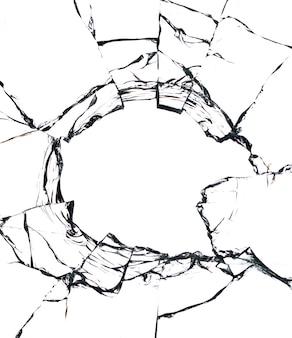 Collage de fissures dans le verre, un trou de balles dans le verre sur fond blanc. texture de verre de fenêtre.