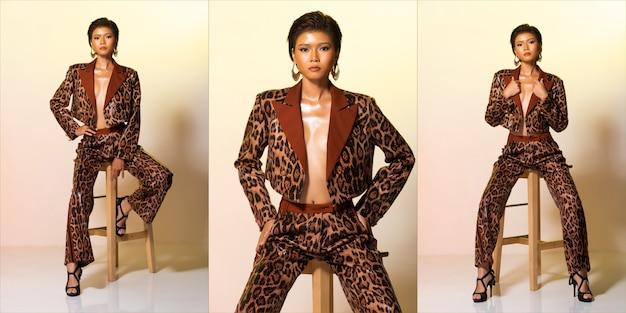 Collage group pack pleine longueur de la mode jeune peau bronzée mince femme asiatique cheveux courts porter un pantalon de veste en peau de tigre léopard, s'asseoir sur une chaise de tabouret sexy pose des talons hauts. studio fond jaune