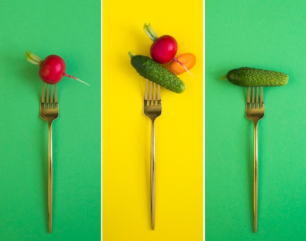 Collage de légume empalé sur une fourchette d'or sur le fond coloré. fermer.