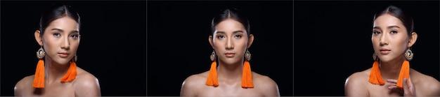 Collage trois groupe de belle femme bronzée à la peau propre enveloppée de cheveux noirs avec des boucles d'oreilles en fil orange sourire, éclairage de studio espace de copie de fond noir, filles asiatiques avec coeur d'amour de visage d'oeil de mode