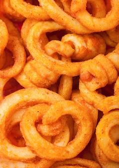 Collation de restauration rapide frites frisées. macro