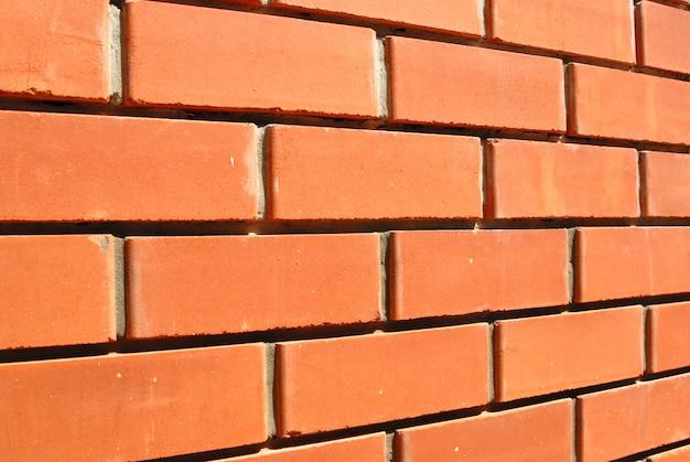 Collection d'arrière-plans - fragment d'un mur de briques briques et ciment