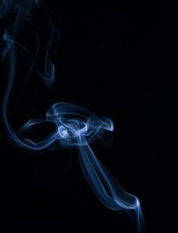 Collection de fumée blanche sur fond noir