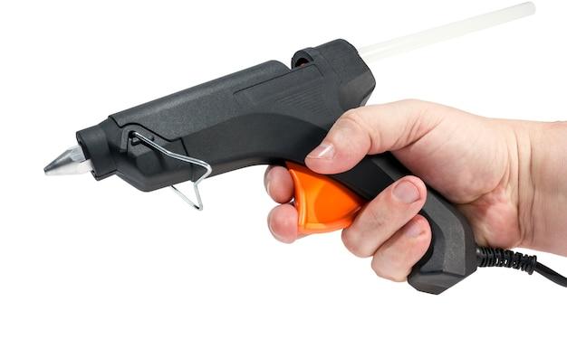 Collection d'outils - pistolet à colle chaude électrique isolé sur fond blanc.