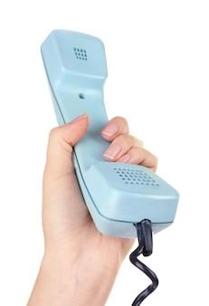 Combiné téléphonique rétro en main, sur blanc