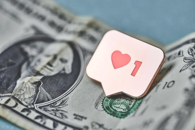 Comme le symbole du coeur sur le dollar. comme le bouton de signe, symbole avec coeur et un chiffre. achetez des abonnés pour le marketing des réseaux sociaux. concept de prix bon marché.