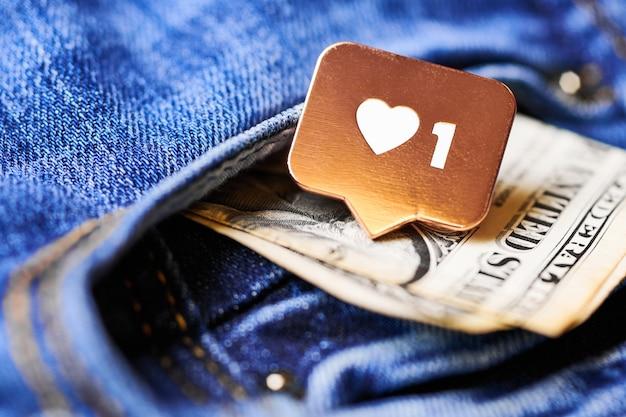 Comme le symbole du coeur et le dollar dans la poche de jeans. comme le bouton de signe, symbole avec coeur et un chiffre. marketing de réseau de médias sociaux.