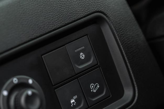 Commutateur de volant chauffant. vue rapprochée du panneau de commande du chauffage du volant.