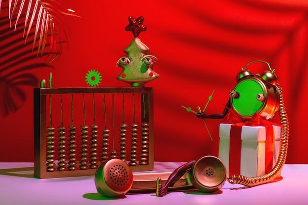 Composition abstraite rouge de noël et du nouvel an avec arbre, horloge, cadeau et téléphone.
