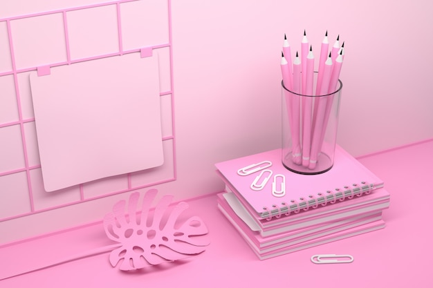 Composition du lieu de travail de bureau rose avec motebooks et crayons