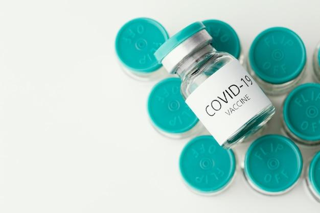 Composition avec flacon de vaccin contre le coronavirus