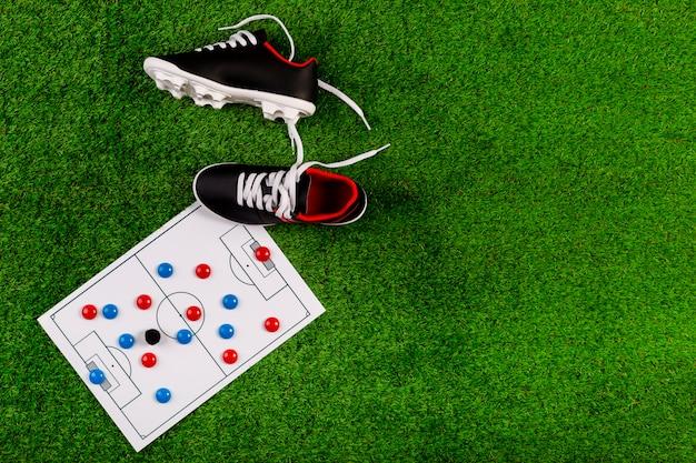 Composition de football avec planche et chaussures