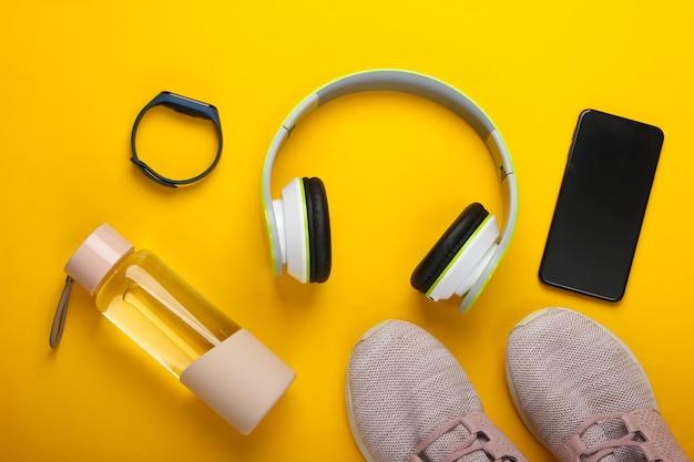 Composition à plat de gadgets modernes pour le sport et le fitness