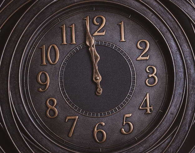 Compte à rebours jusqu'à minuit. horloge de style rétro avec chiffres en or indiquant une minute à minuit.