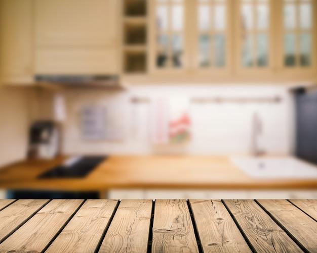 Comptoir en bois avec arrière-plan flou de cuisine