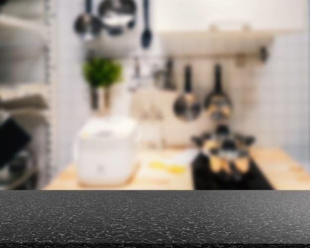 Comptoir de granit avec cuisine arrière-plan flou
