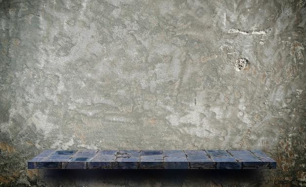 Comptoir de tablette en pierre grise sur ciment gris pour présentation du produit