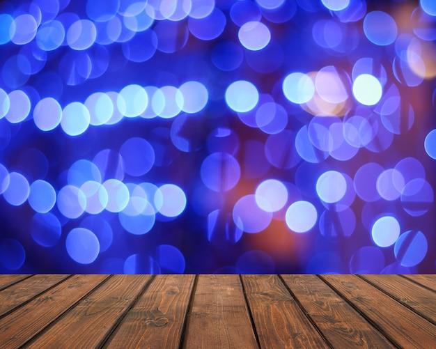 Comptoir vide sur un arrière-plan flou bleu avec bokeh. planches de bois de texture; plancher en bois. espace vide pour votre sujet.