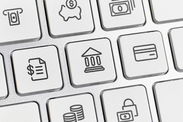 Concept de banque en ligne avec des icônes de services et de clavier.