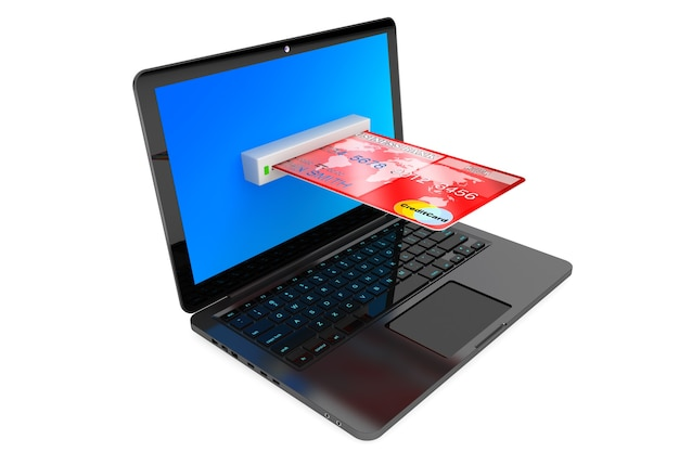 Concept de commerce électronique. ordinateur portable et carte de crédit sur fond blanc