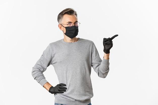 Concept de coronavirus, mode de vie et quarantaine. image d'un homme d'âge moyen à lunettes, masque médical