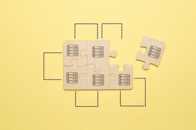 Le concept de création d'une ferme à partir de blocs informatiques pour l'exploitation minière avec des icônes sur un puzzle.