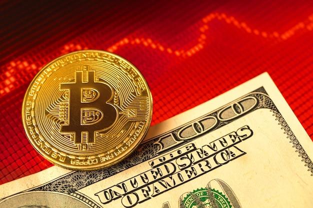 Concept de crise du bitcoin avec des billets en dollars sur l'arrière-plan, un graphique boursier rouge et des graphiques photo