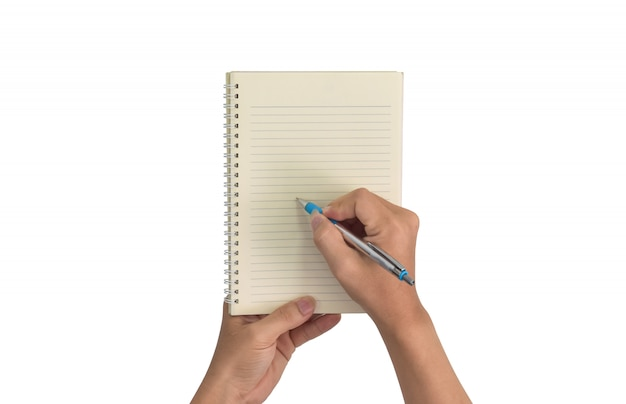 Concept de design, main avec un stylo écrit vierge dans un cahier isolé