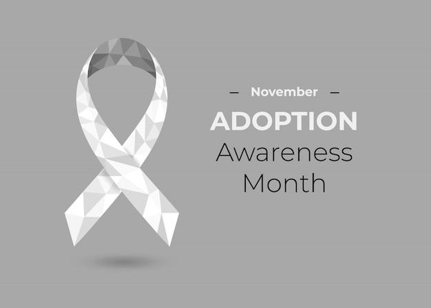 Concept du mois de sensibilisation à l'adoption avec ruban de sensibilisation blanc sur fond gris