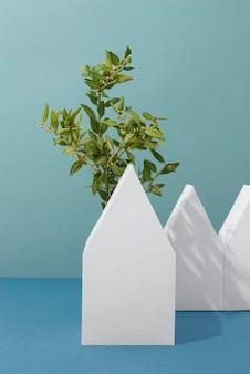 Concept de durabilité avec des plantes poussant à partir de formes géométriques