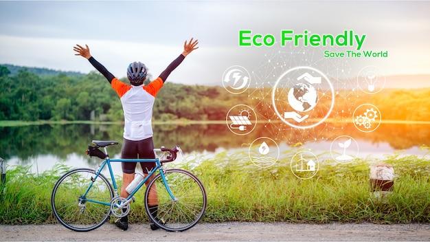 Concept écologique, énergie verte, réduction du dioxyde de carbone et réduction de la pollution. concept de journée sans voiture pour sauver le monde et sauver la terre. un homme fait du vélo au milieu de la nature.