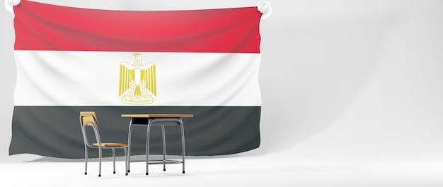 Concept d'éducation. 3d de bureau et drapeau de l'égypte sur fond blanc.