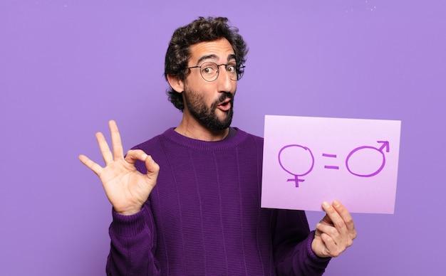 Concept d'égalité des sexes jeune homme barbu