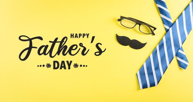 Concept de fond de fête des pères heureux avec des lunettes à cravate bleue et une moustache avec le texte