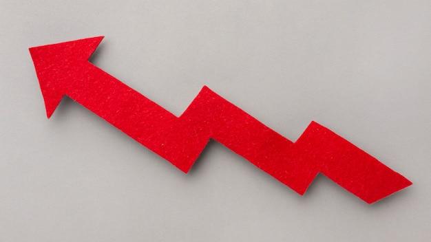 Concept graphique avec flèche rouge