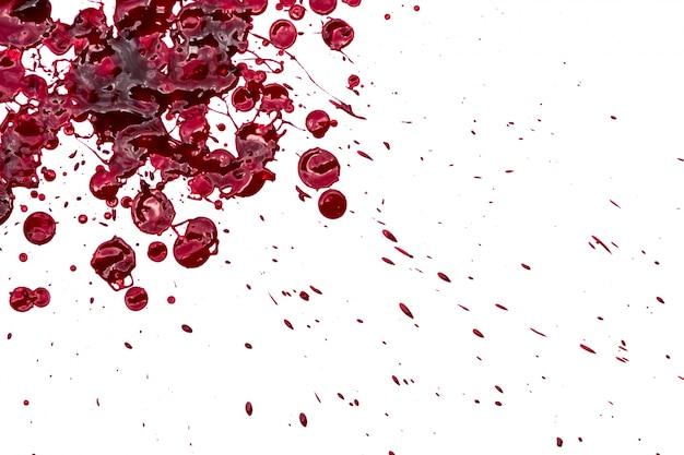 Concept de halloween: éclaboussures de sang sur fond blanc