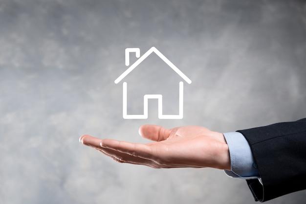 Concept immobilier, homme affaires, tenue, a, maison, icon., maison, sur, hand., assurance propriété, et, sécurité, concept. protéger le geste de l'homme et le symbole de la maison.