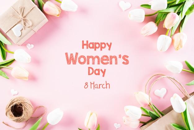 Concept de la journée internationale de la femme sur fond pastel rose