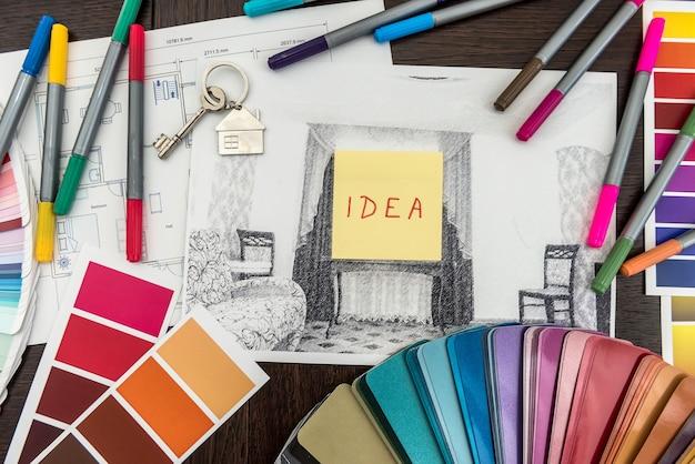 Concept de logement architectural et technique. palette de dessins de couleurs pour les travaux d'intérieur sur les plans, pinceau, autocollant