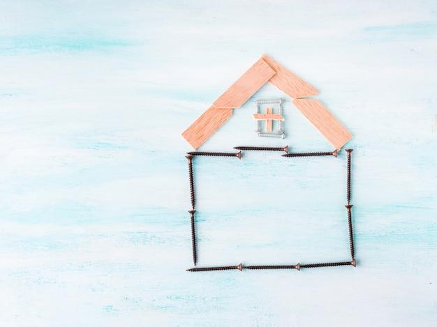Concept de maison de construction plat poser avec vis et bois