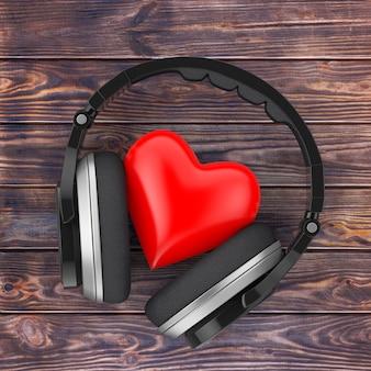 Concept de musique d'amour. casque sans fil noir et coeur rouge sur une table en bois. rendu 3d