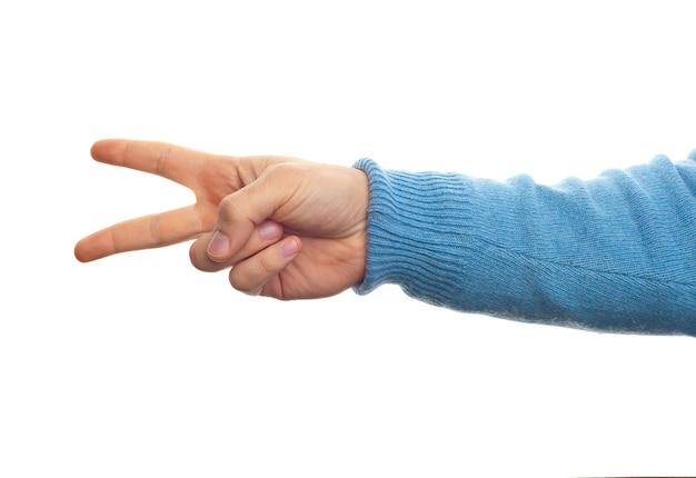 Concept de numéro deux ou de ciseaux avec la main sur fond blanc