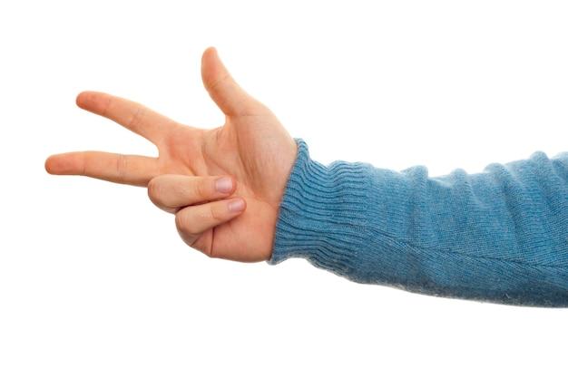 Concept de numéro trois avec la main sur fond blanc