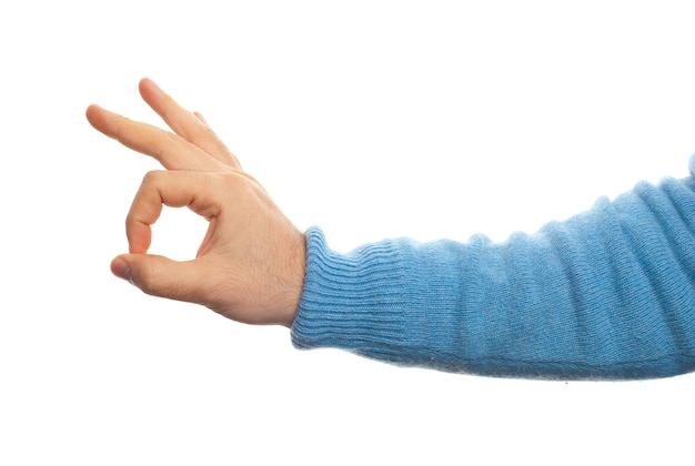 Concept d'ok avec la main sur fond blanc
