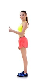 Concept de posture incorrecte. jeune femme montrant le pouce vers le haut geste sur fond blanc