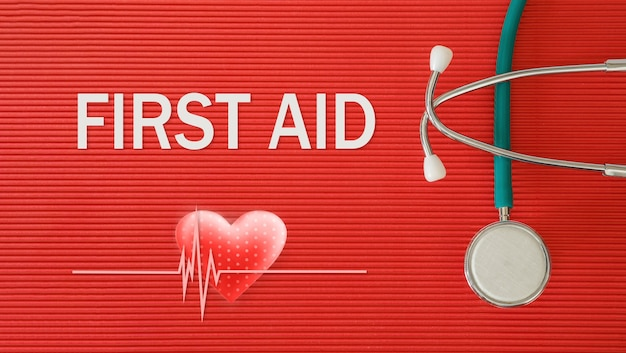 Concept de premiers soins avec stéthoscope et forme de coeur sur fond rouge