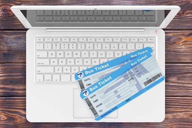 Concept de réservation en ligne. billets de bus avec ordinateur portable sur table en bois gros plan extrême. rendu 3d
