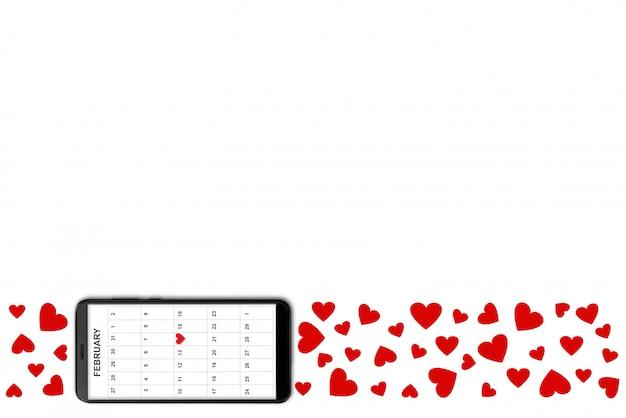 Concept de la saint-valentin, sur fond blanc isolé coeurs de papier rouge et téléphone avec calendrier à l'écran