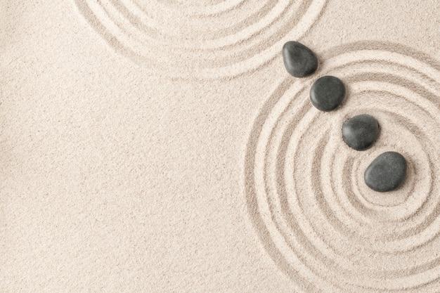 Concept de santé et bien-être de fond de sable de pierres zen